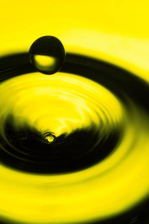 high angle view of a water drop bouncing from the surface, focus on the swirl head Stock Photo - 17813743
