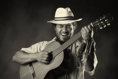 guitarists: Rastafarian man playing classic guitar Stock Photo