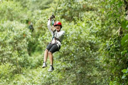 zipline adventure in ecuadorian rainforest, banos de agua santa photo