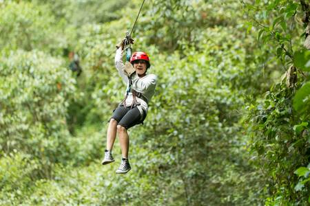 tungurahua: zipline adventure in ecuadorian rainforest, banos de agua santa Stock Photo