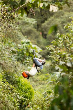 recreational sports: zipline adventure in ecuadorian rainforest, banos de agua santa Stock Photo