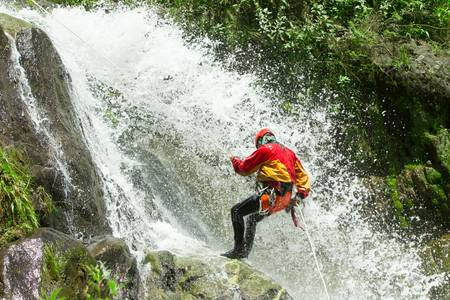 waterfall descent by a professional canyoning istructor.