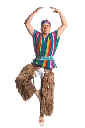 traditional costume: ecuadorian dancer dressed up in traditional costume from the highlands, llama or alpaca pants. studio shot isolated on white.