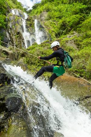 canyoning guide trying out a new route in chama waterfall, banos de agua santa, ecuador Reklamní fotografie