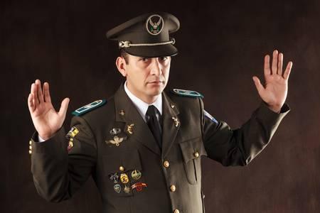 surrender: ecuadorian police official dressed up in formal uniform