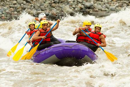 rowing boat: a group of men and women, with a guide, white water rafting on the patate river, ecuador Stock Photo