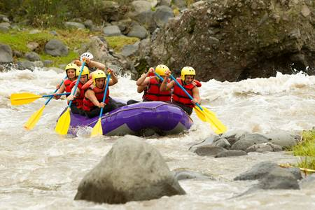 team journey: a group of men and women, with a guide, white water rafting on the patate river, ecuador Stock Photo