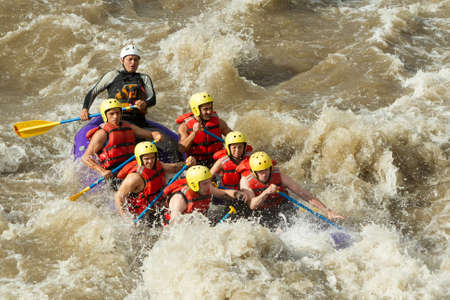 adrenaline: a group of men and women, with a guide, white water rafting on the patate river, ecuador Stock Photo