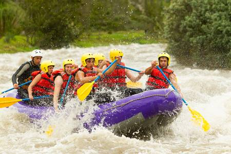 a group of men and women, with a guide, white water rafting on the patate river, ecuador Stock Photo