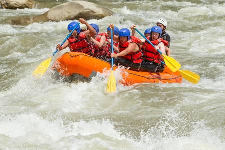 white water rafting team in bright sunlight, pastaza river, ecuador, sangay national park.