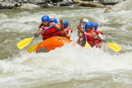 white water rafting team in bright sunlight, pastaza river, ecuador, sangay national park. photo