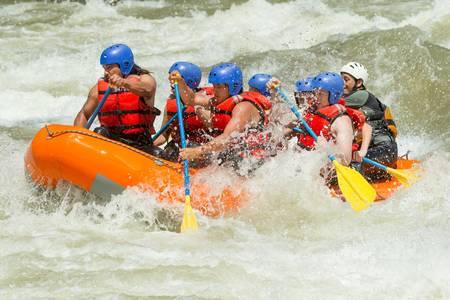 rafting: white water rafting team in bright sunlight, pastaza river, ecuador, sangay national park.