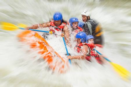 whitewater: white water rafting team in bright sunlight, pastaza river, ecuador, sangay national park.