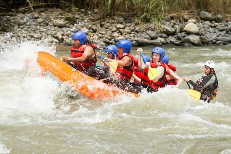 expedition: white water rafting team in bright sunlight, pastaza river, ecuador, sangay national park.