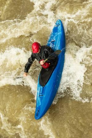 kayaker: river rafting in kayak, ecuador , south america