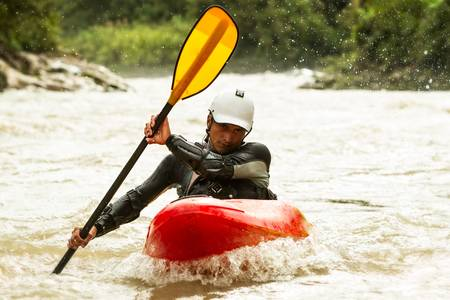 dynamic activity: river rafting in kayak, ecuador , south america