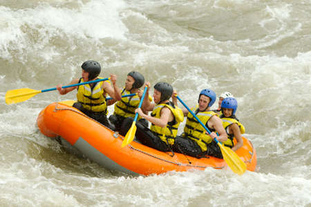 whitewater: a group of men and women, with a guide, white water rafting on the patate river, ecuador Stock Photo