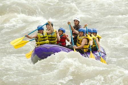 persevere: a group of men and women, with a guide, white water rafting on the patate river, ecuador Stock Photo