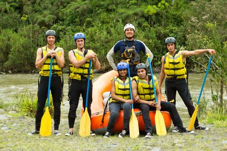 raft: large group of young people ready to go rafting