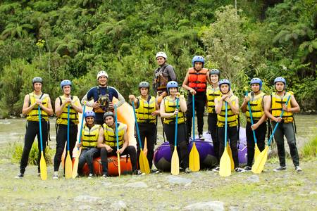 man outdoors: large group of young people ready to go rafting