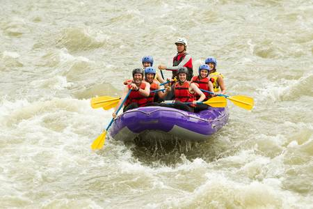 whitewater rafting boat, group of seven people Standard-Bild