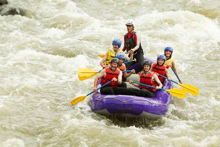 Whitewater rafting boat, group of seven people photo