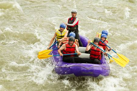 whitewater rafting boat, group of seven people Stock Photo