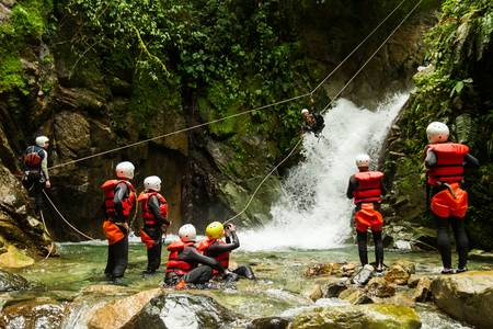 group of people having fun during a canyoning trip.