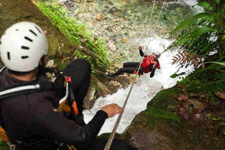 extreme angle: Adult man zipline experience in South America. Stock Photo