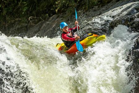 black white kayak: waterfall kayak jump , sangay national park, ecuador Stock Photo