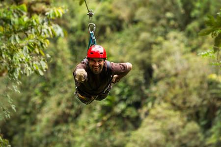 zipline adventure in ecuadorian rainforest, banos de agua santa Archivio Fotografico