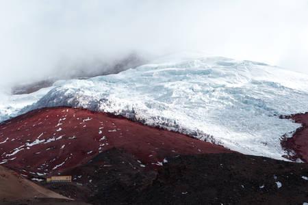 stock vista: thick glacier on cotopaxi volcano, jose rivas  refugee at the base, ecuador Stock Photo