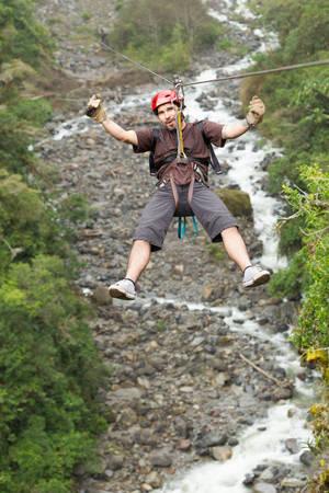 adult man, zip line adventure in ecuadorian rainforest. photo