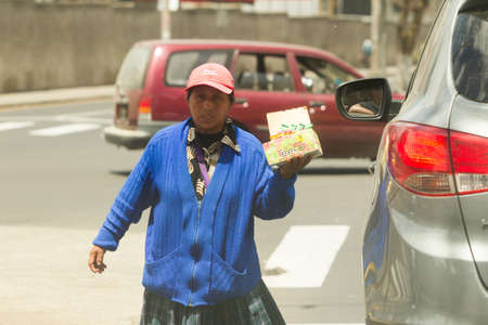 Ambato,Ecuador - January 24,2012: Since begging on the streets is ilegal, poor people sels overpriced candies to make a living, as seen on streets of Ambato,Ecuador - January 24,2012