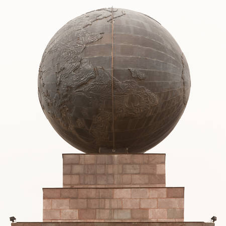 0 geography: stone sphere on top of equator monument, quito, ecuador