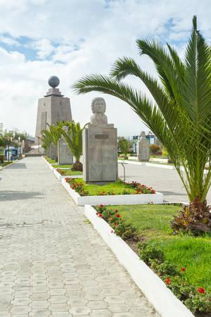 commemorative: commemorative alley, mitad del mundo, (center of the world) quito, ecuador. equator monument in the background