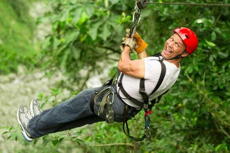 adult man on zip line, ecuadorian andes