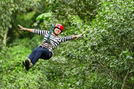 adult woman on zip line, ecuadorian andes