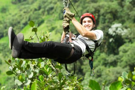 adult man on zip line, andes rain forest in ecuador Archivio Fotografico