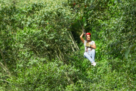 Young woman on zip line photo