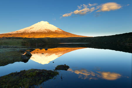 santo: Cotopaxi volcano reflecting in Santo Domingo lagoon