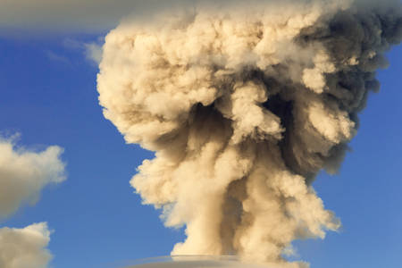 vulcanology: mushroom cloud from tungurahua volcano explosion in ecuador, south america
