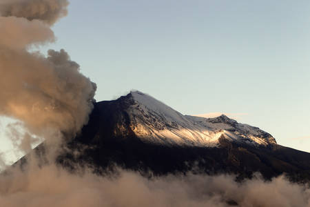 tungurahua: susnet light over tungurahua volcano erupting, view from chimborazo county