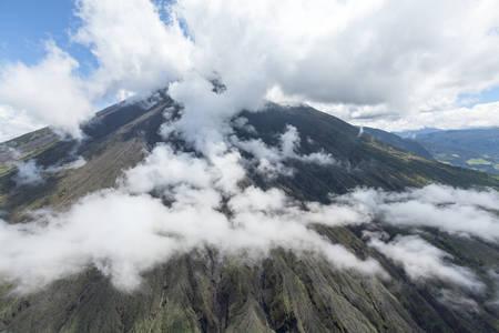 strombolian: helicopter shot of tungurahua volcano, ecuador