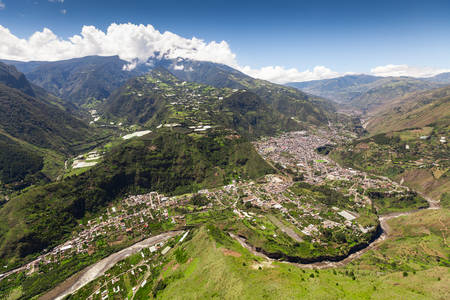 tungurahua: banos de agua santa aerial shot from nne, pastaza river in the foregraound and tungurahua volcano in the background Stock Photo