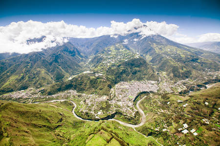 bird eye view: aerial shot of banos de agua santa, north to south, tungurahua volcano in the background and pastaza river in foreground Stock Photo