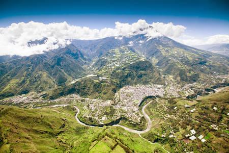 tungurahua: aerial shot of banos de agua santa, north to south, tungurahua volcano in the background and pastaza river in foreground Stock Photo