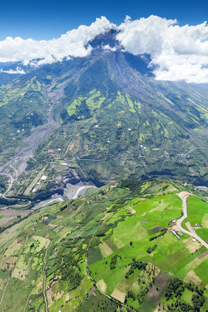 strombolian: tungurahua volcano aerial wide angle, chambo river valley on the right side, high altitude helicopter shot,