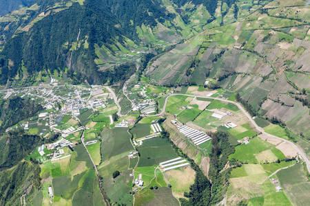 top angle: ecuadorian farmland aerial shot , tungurahua province, high altitude , full size helicopter