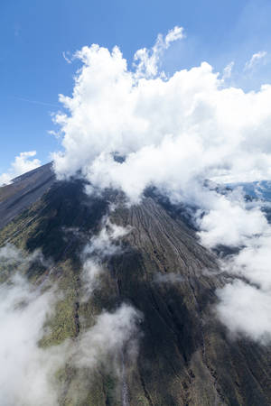 activ: aerial shot of tungurahua volcano, central ecuador, high altitude from full size helicopter.